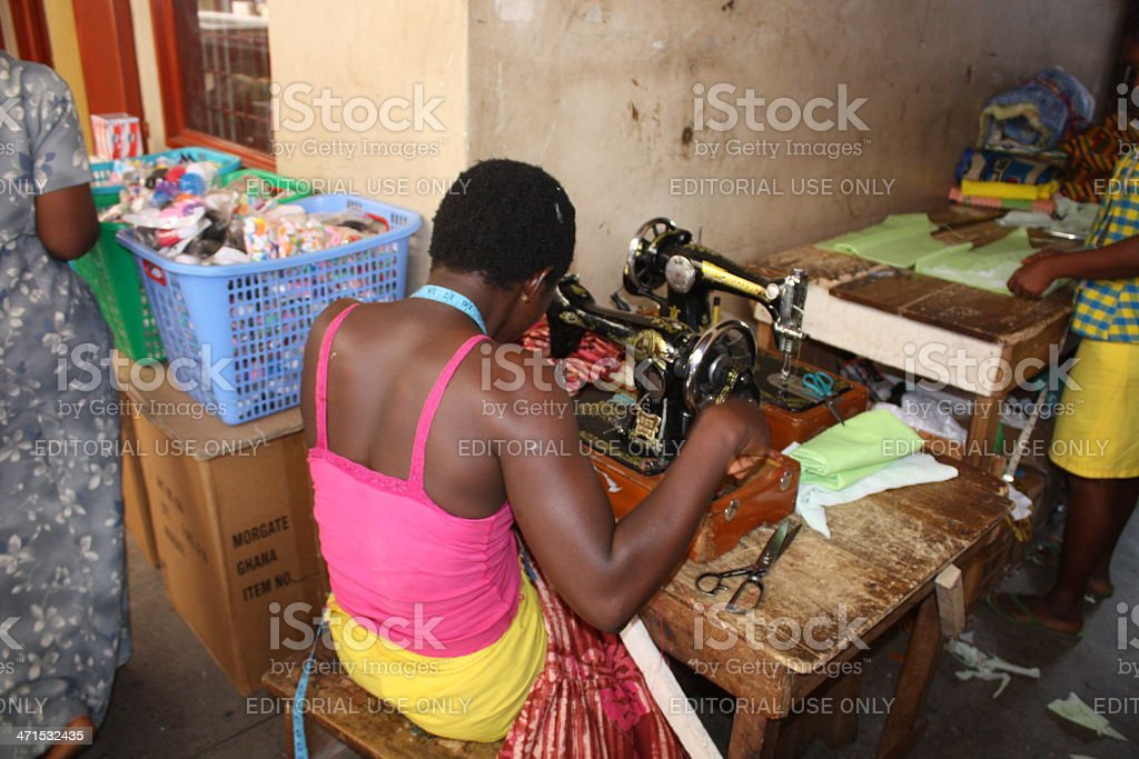 Tailor at an old sewing machine in Accra, Ghana, stock photo
