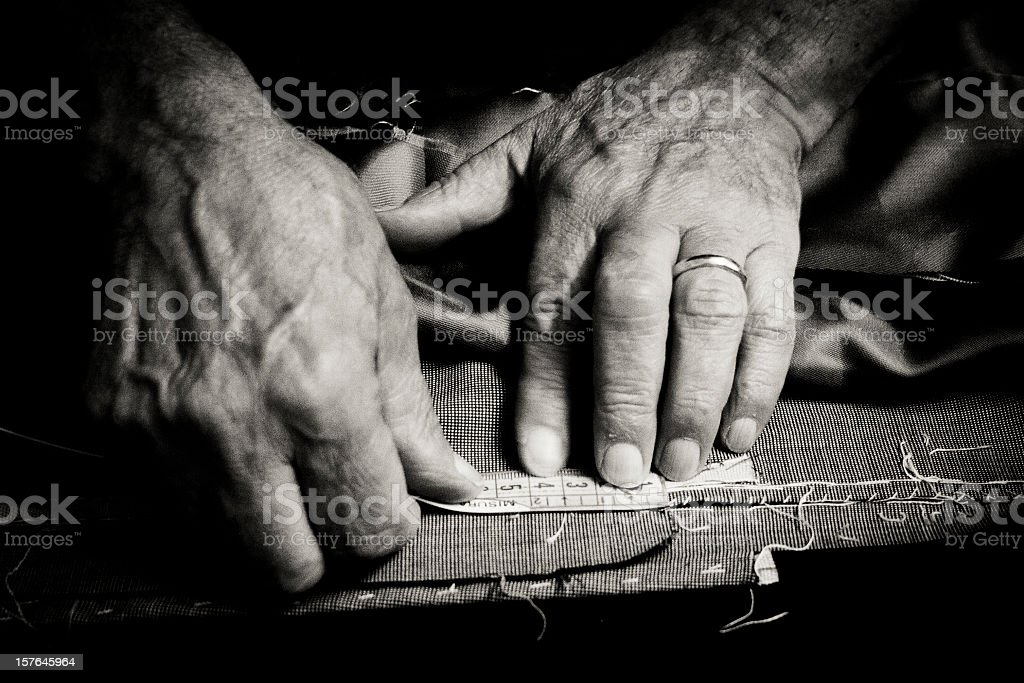 Tailor at work stock photo