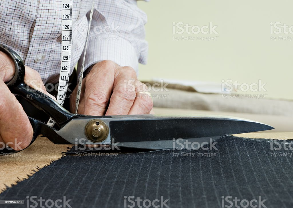 Tailor At Work With a Pair of Shears stock photo