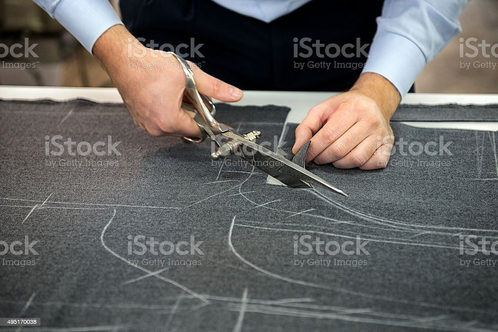 Tailor cutting fabric stock photo