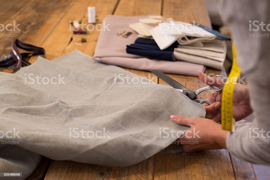 Tailor cutting fabric stock photo