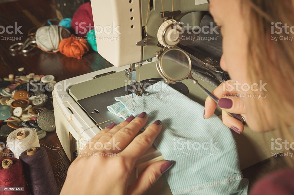 Tailor in her retro shop. stock photo