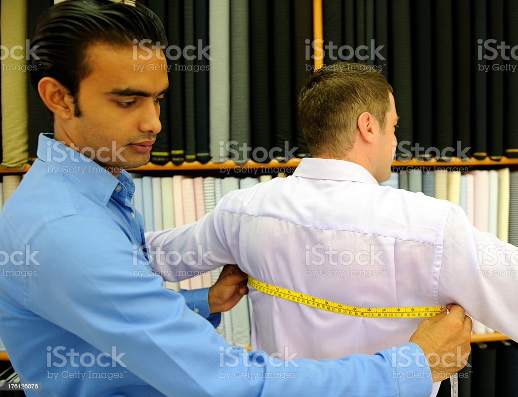 Tailor Measuring Back royalty-free stock photo
