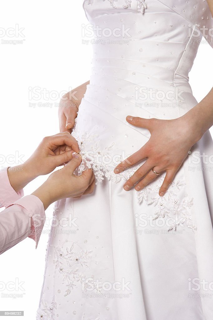 Tailor sew dress of bride royalty-free stock photo