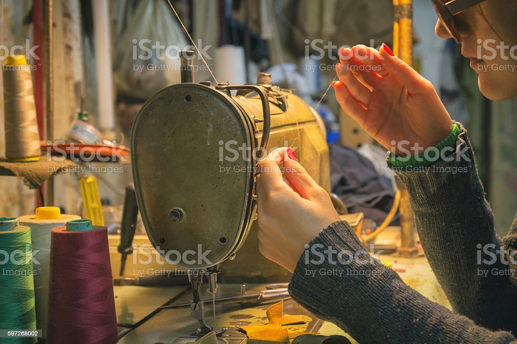 Tailor sewing on a machine. stock photo