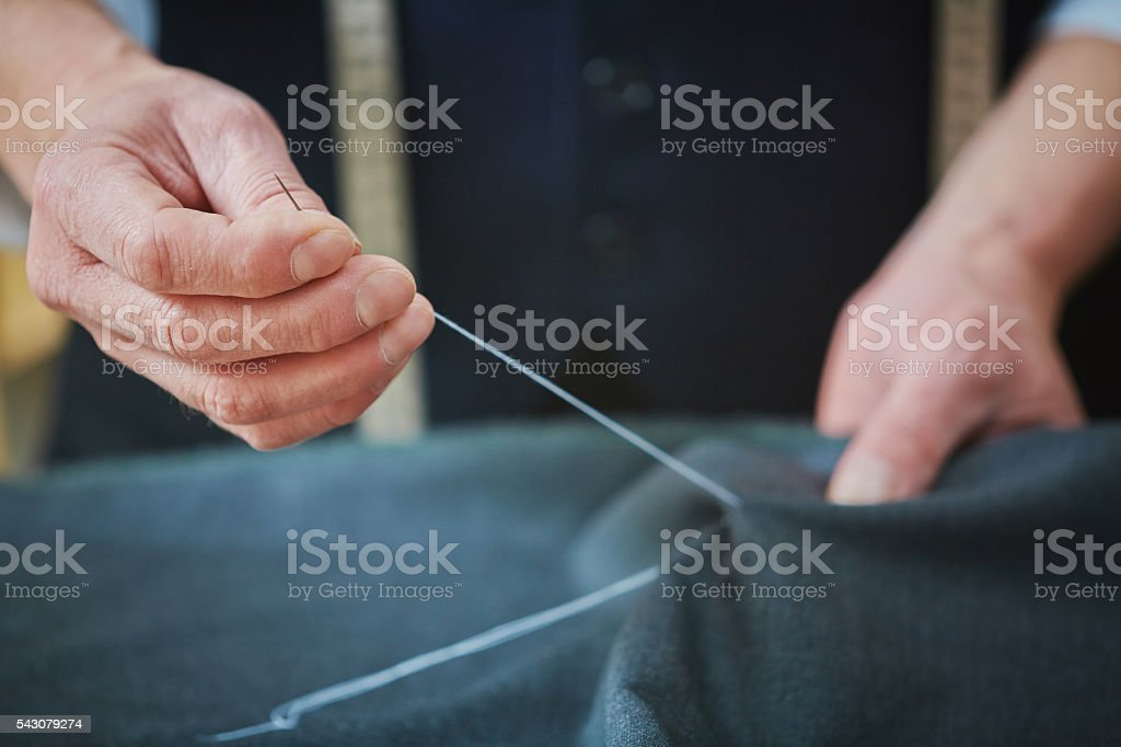 Tailor sewing stock photo
