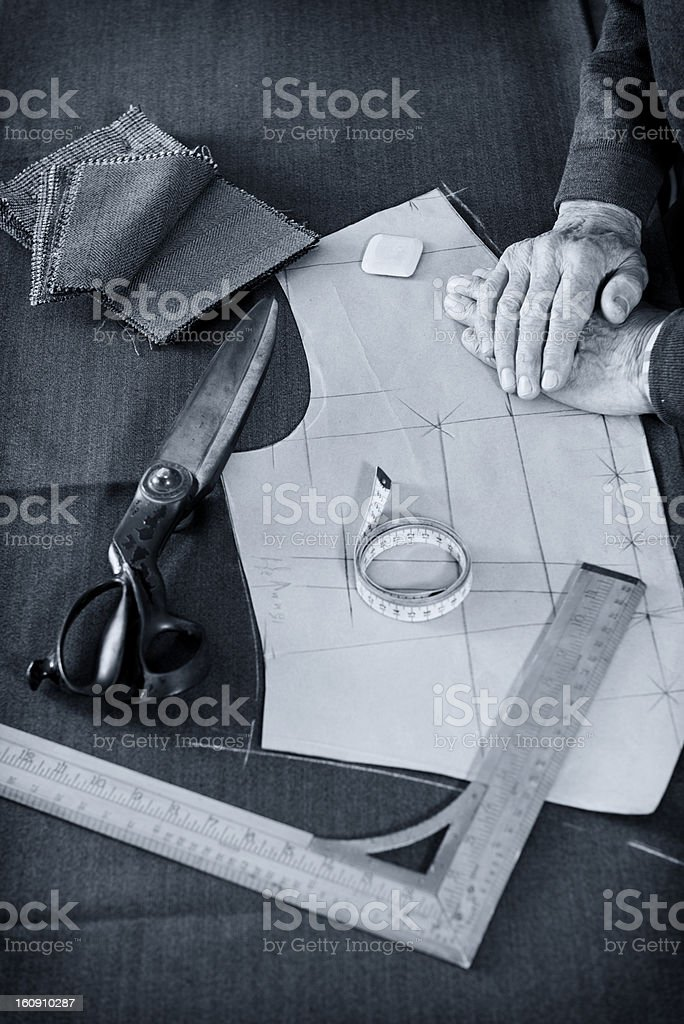 Tailor Starting Work With His Tools stock photo