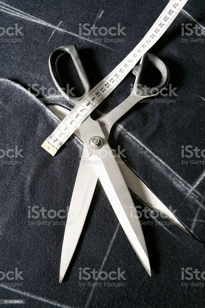 Tailor Tools of Trade - Scissors and Tape Measure. stock photo