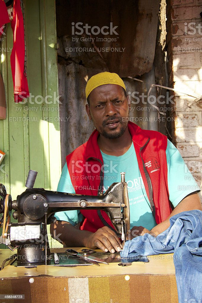Tailor with sewing machine royalty-free stock photo