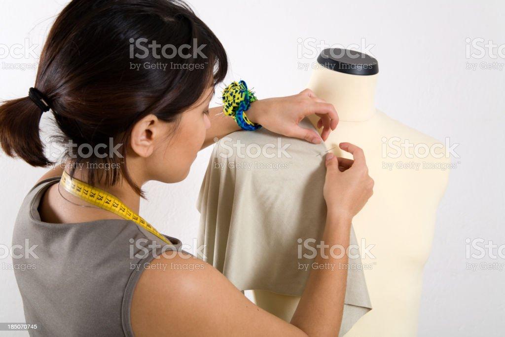 Tailor working on a mannequin royalty-free stock photo