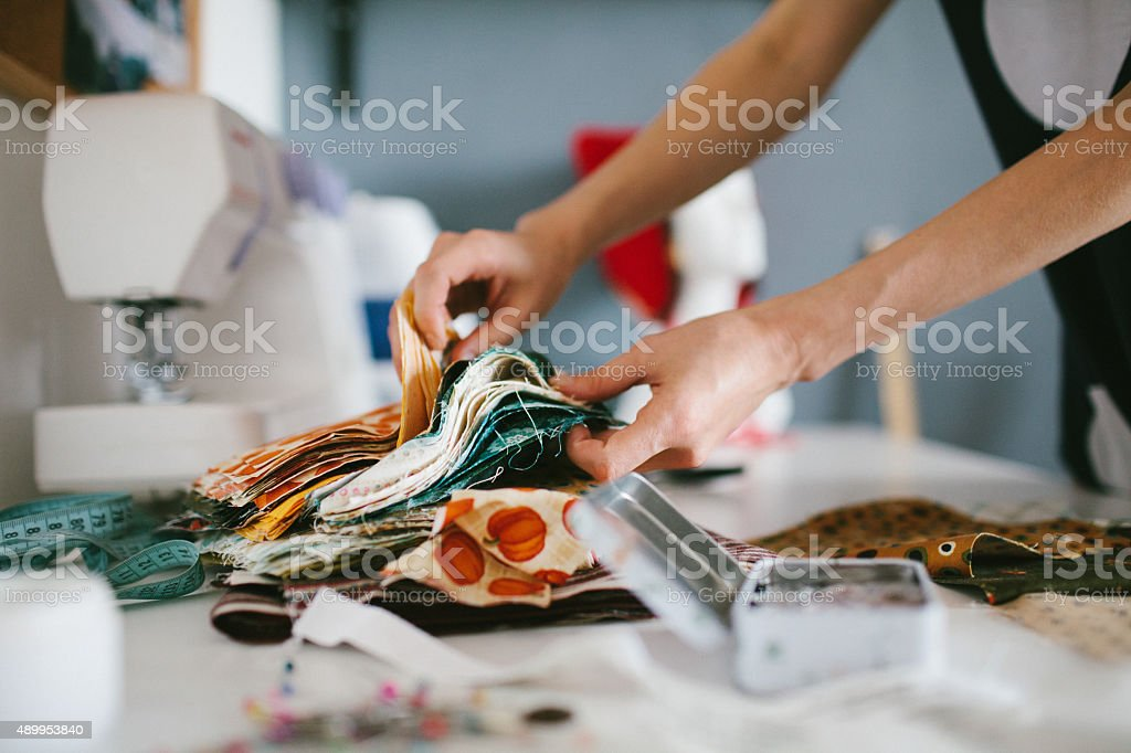Tailor working on sewing machine stock photo