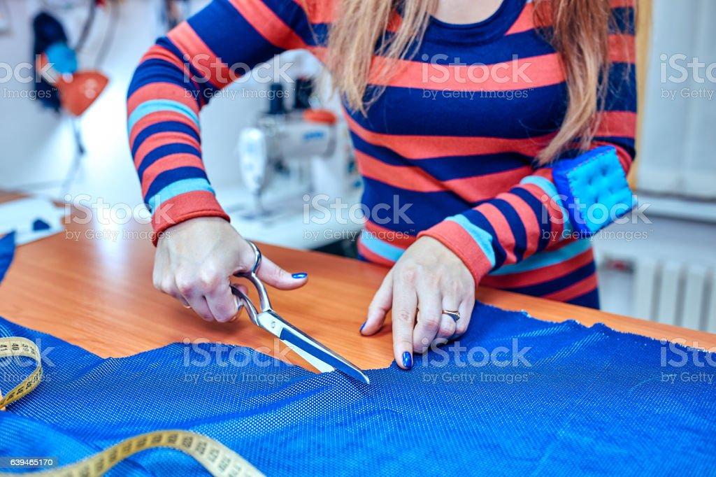 Tailor.Hands notch tailor tailor's scissors cloth stock photo