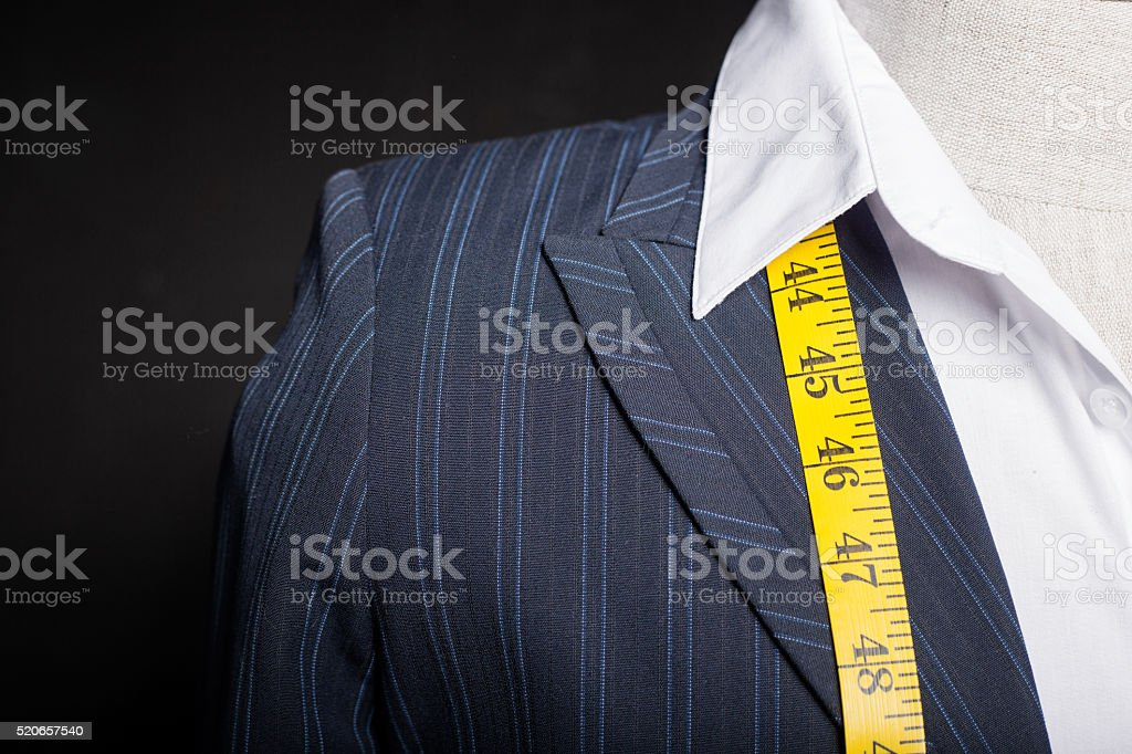 Tailors mannequin with measure tape stock photo