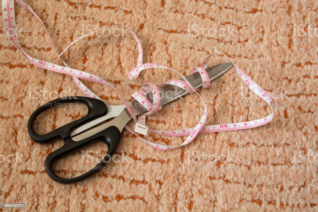Tailor's Measure Tape and Scissors. stock photo