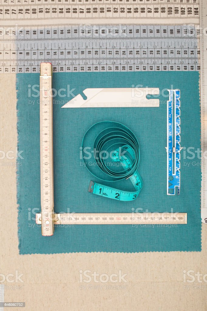 Tailor's Measuring Tools on Green Cloth stock photo