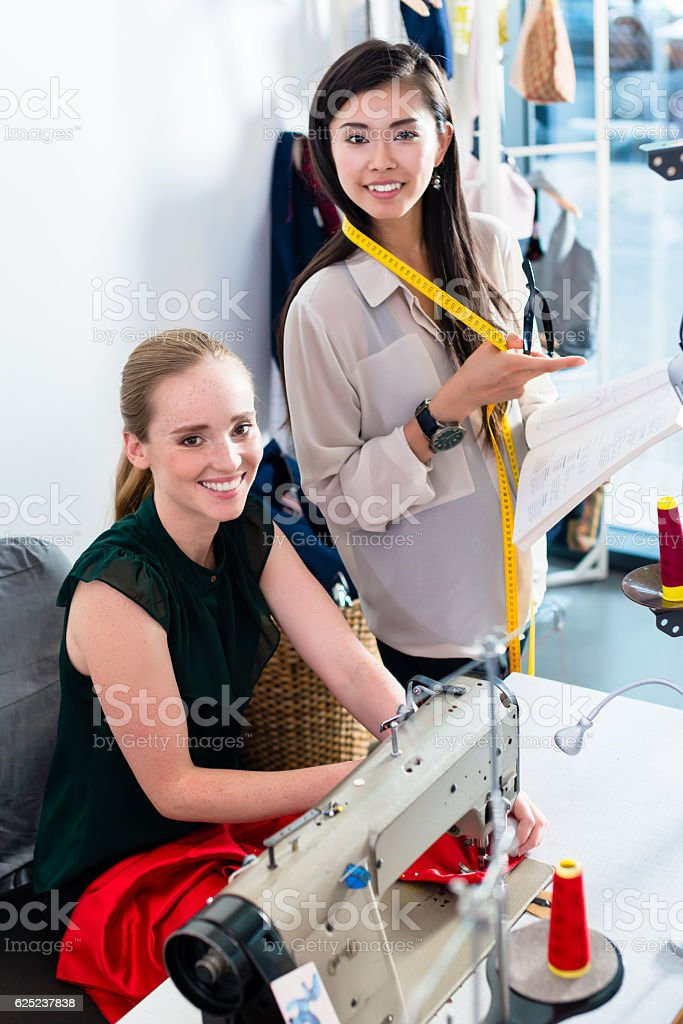 Tailors or fashion designer talk about pattern stock photo