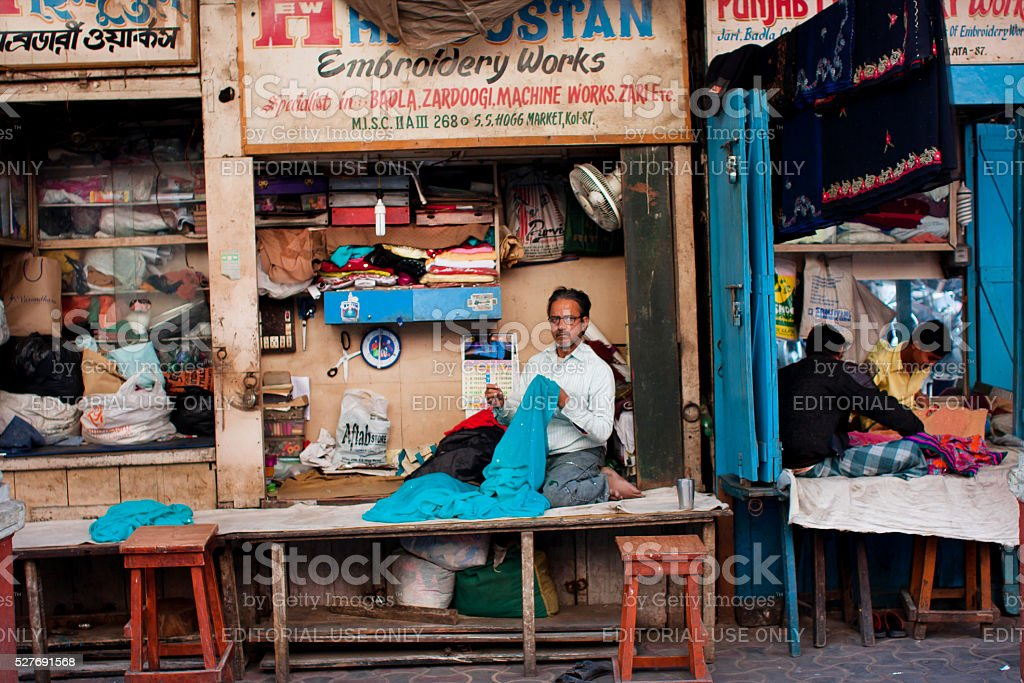 Tailors sew clothes in store of India stock photo