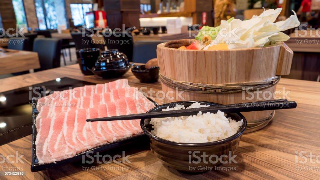 Close up of rice, chopstick, pork and variety vegetable for sukiyaki...