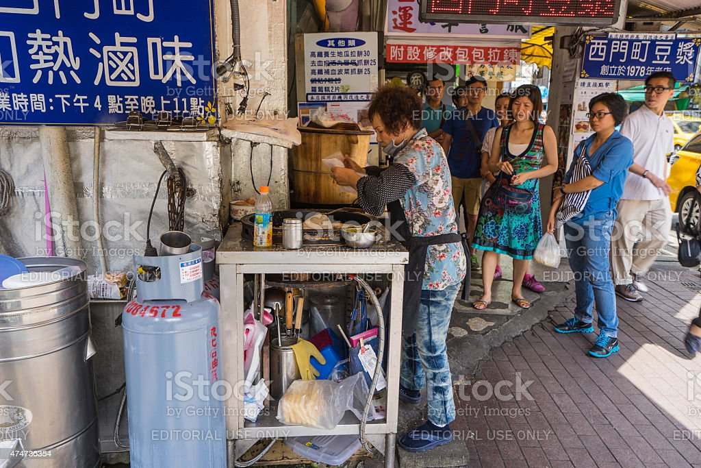 Taiwanese female chef cooking local food stock photo