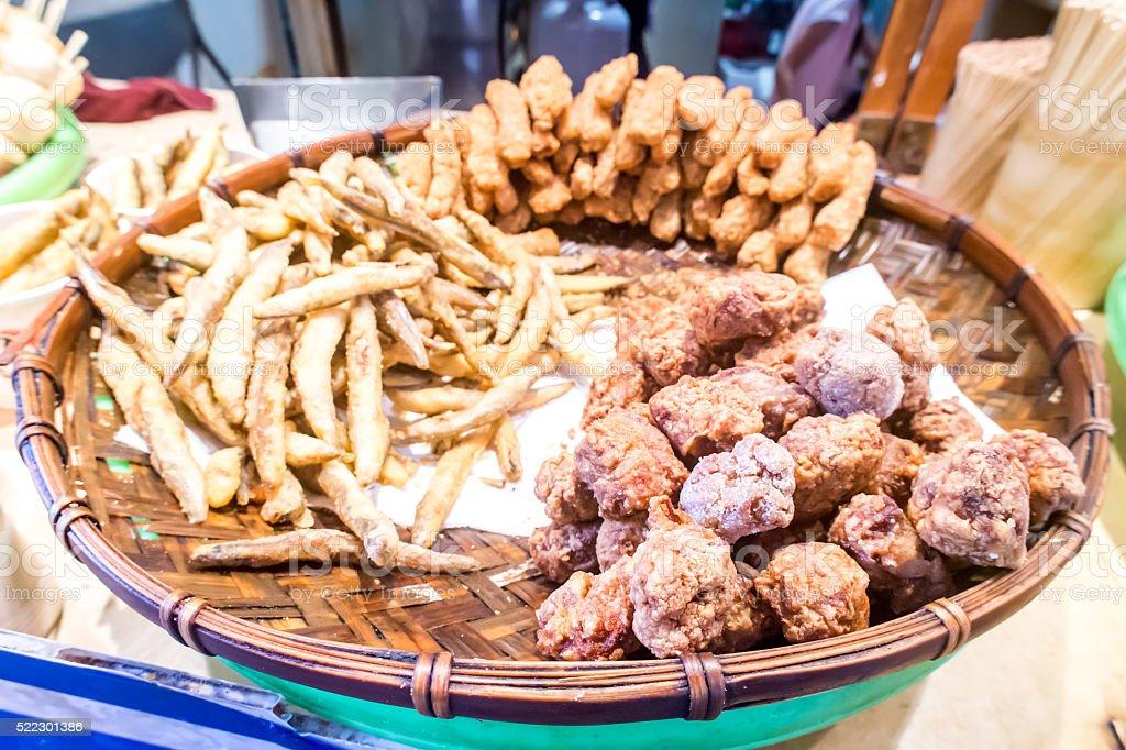 Taiwanese fried crispy sweet potato fries and deep fried popcorn chicken stock photo
