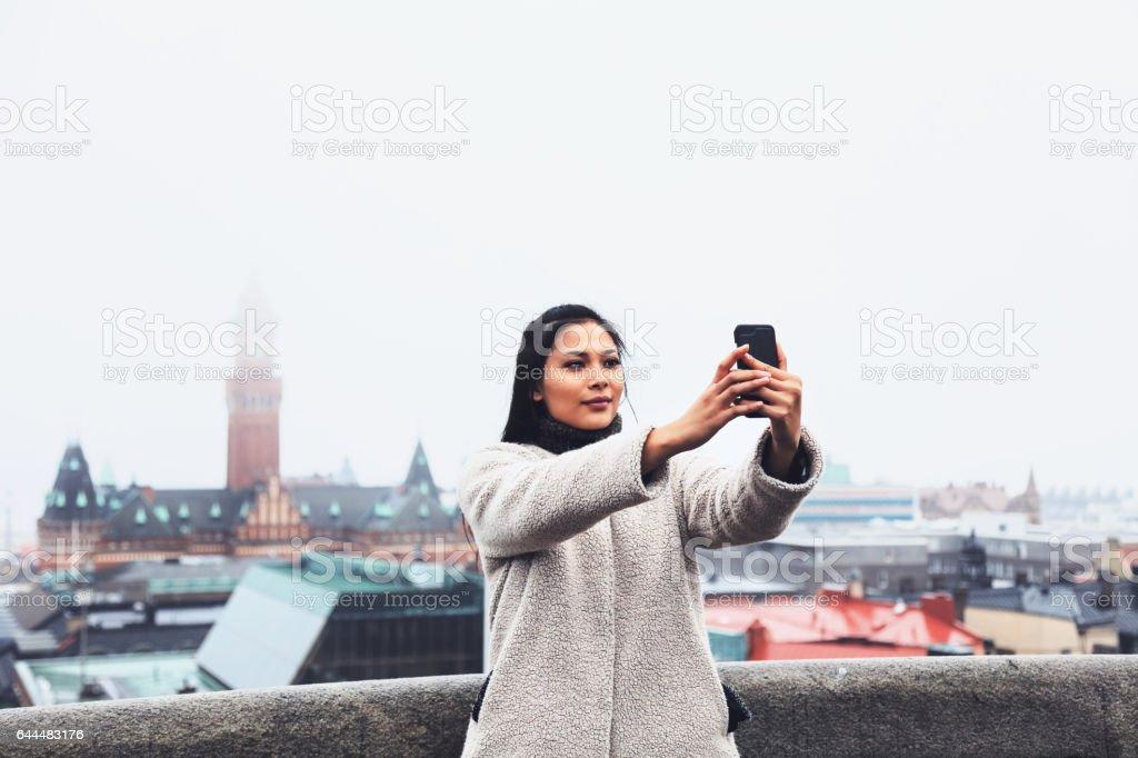 Taiwanese woman take is selfie; Kärnan castle in Helsingborg, Sweden stock photo