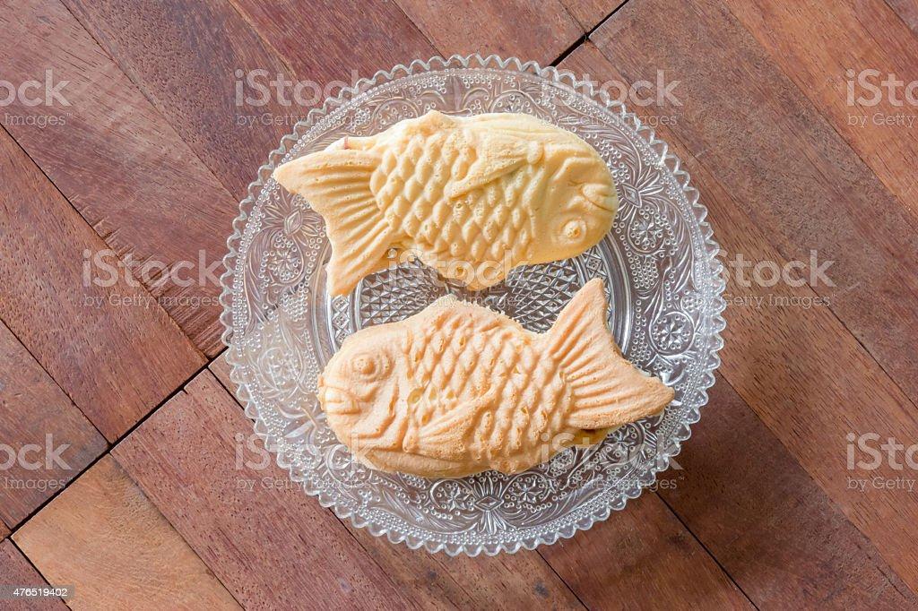Taiyaki cakes on wood background,Japanese confectionery stock photo