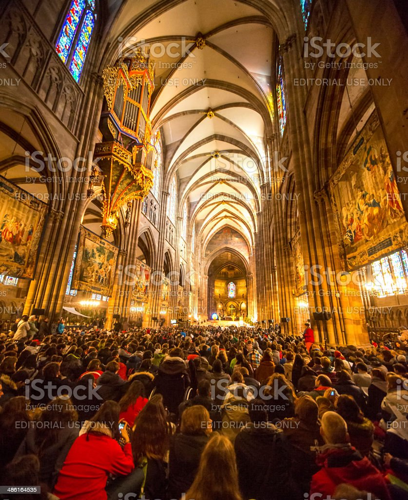 Taize prayer in Notre Damme de Strasbourg, France royalty-free stock photo