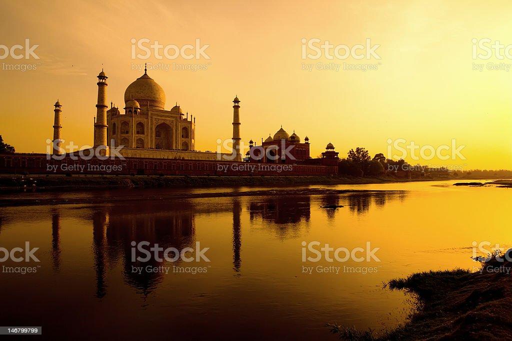 Taj Mahal at sunset refected in the Yamuna river. stock photo