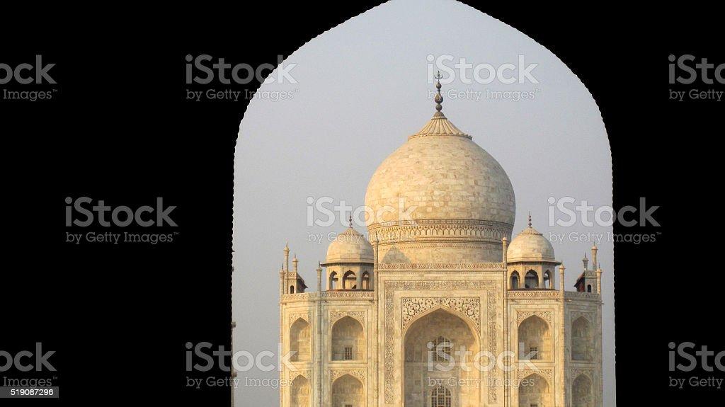 Taj Mahal in the front door frame isolated stock photo