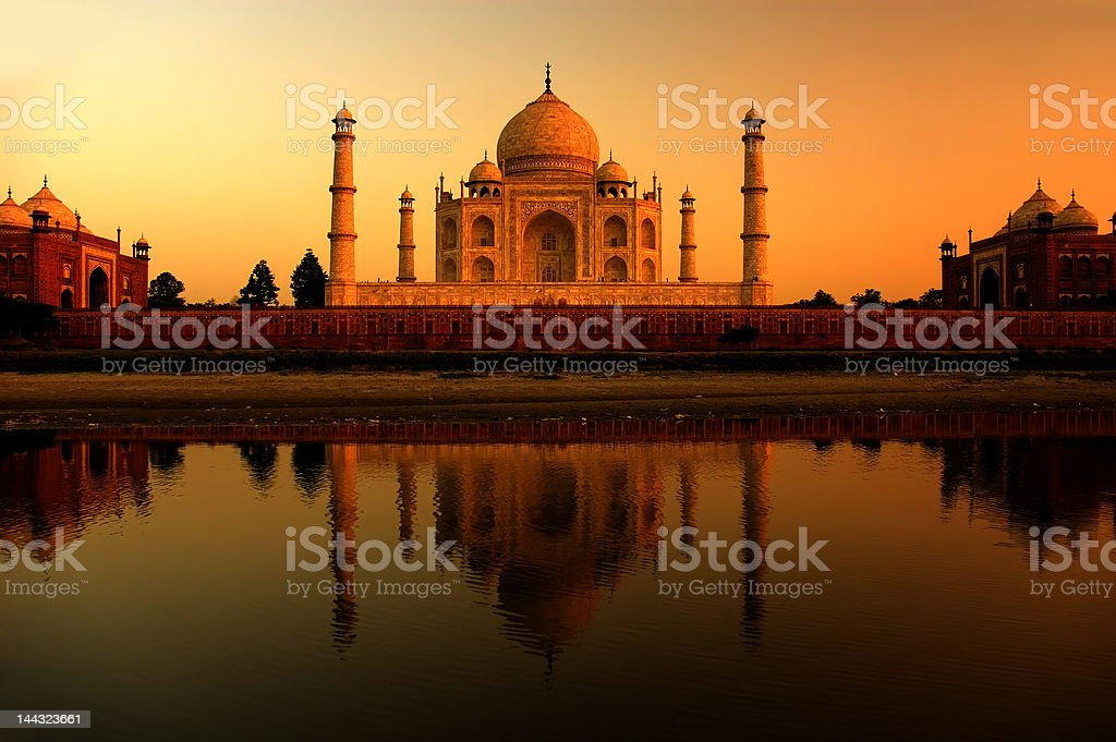 Taj Mahal sunset with reflections stock photo