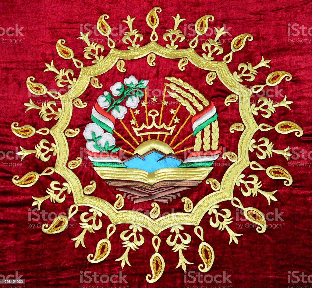 Tajikistan coat of arms - emblem stock photo