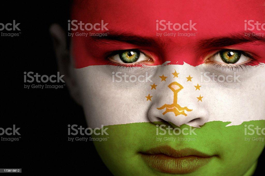 Tajikistan flag boy stock photo