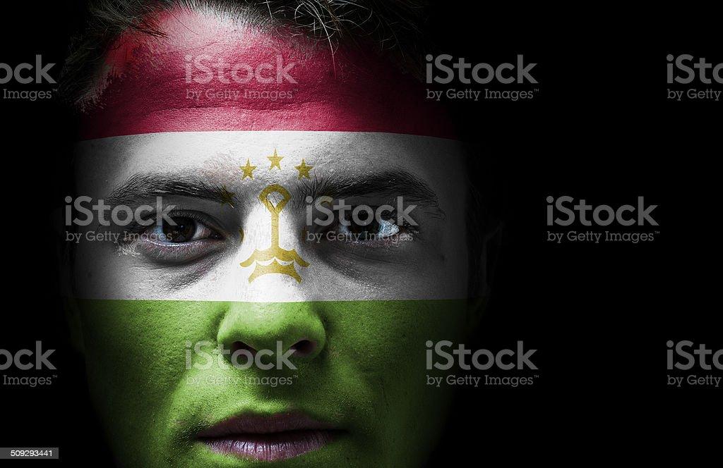 Tajikistan flag on face stock photo