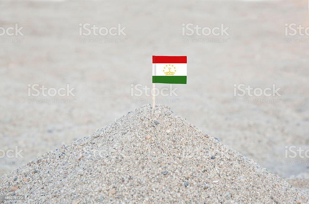 Tajikistan Flag on the Beach stock photo