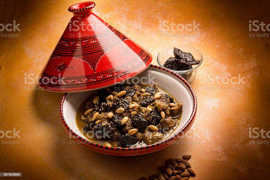 tajine with meat plum almond stock photo