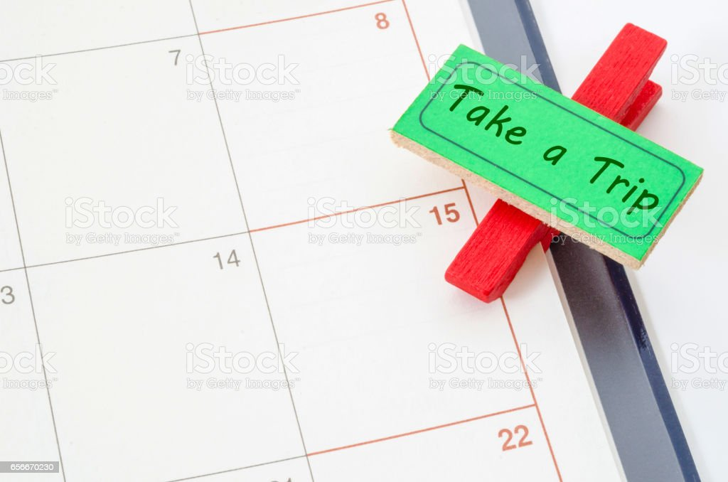 Tak a trip wood clip Tag on schedule stock photo