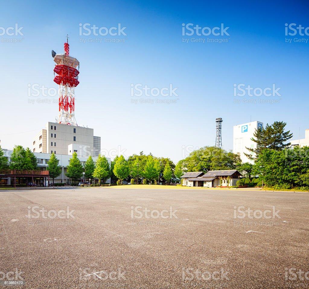 Takasaki Japan empty parking lot with broadcast building stock photo