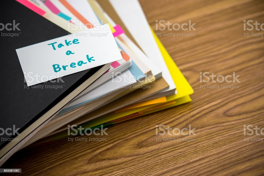 Take a Break; The Pile of Business Documents on the Desk stock photo