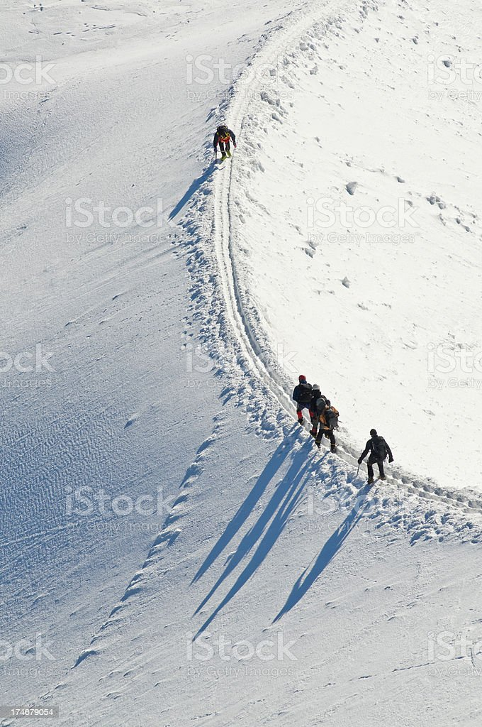 Take a different direction Alpinist shadows royalty-free stock photo