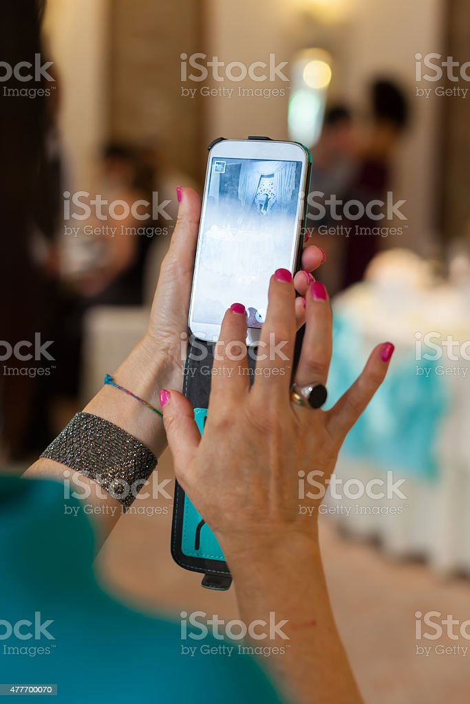 Take a photo with smartphone stock photo