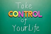 Take control of your life, words on blackboard