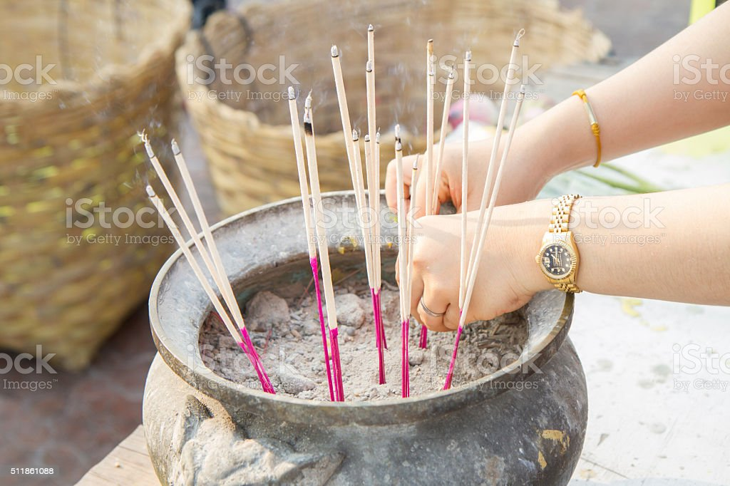 take incense in to the pot stock photo