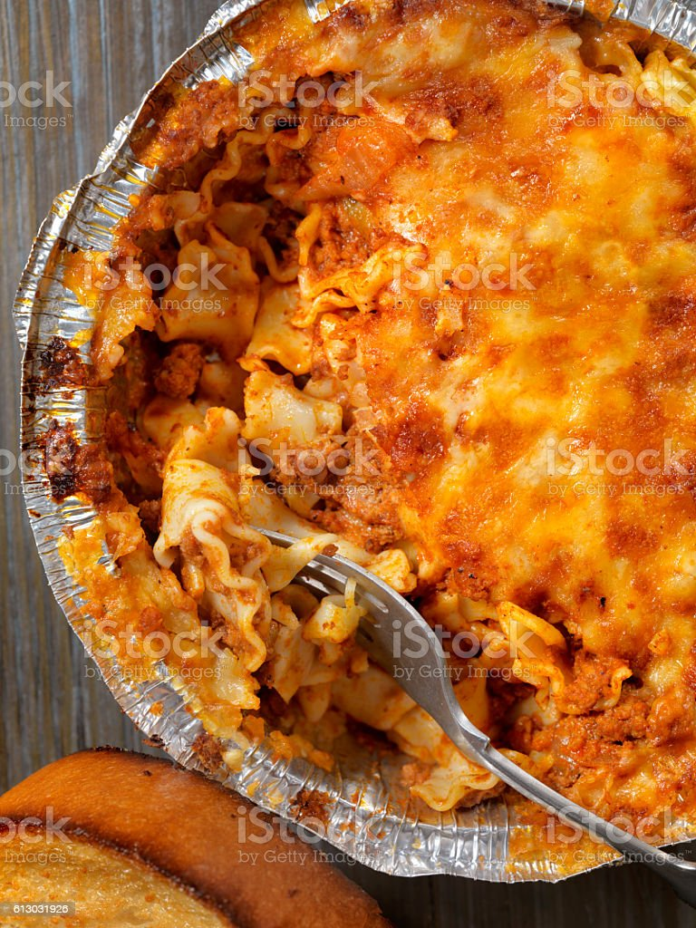 Take Out Lasagna with Garlic Bread stock photo