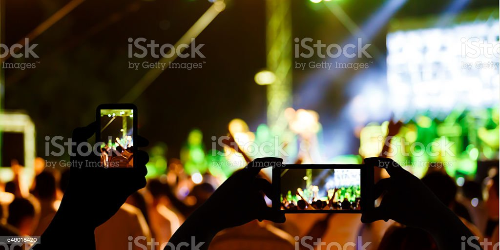 Take photo concert in front of stage stock photo