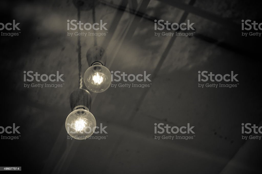 Take the bulb in the coffee shop through glass stock photo