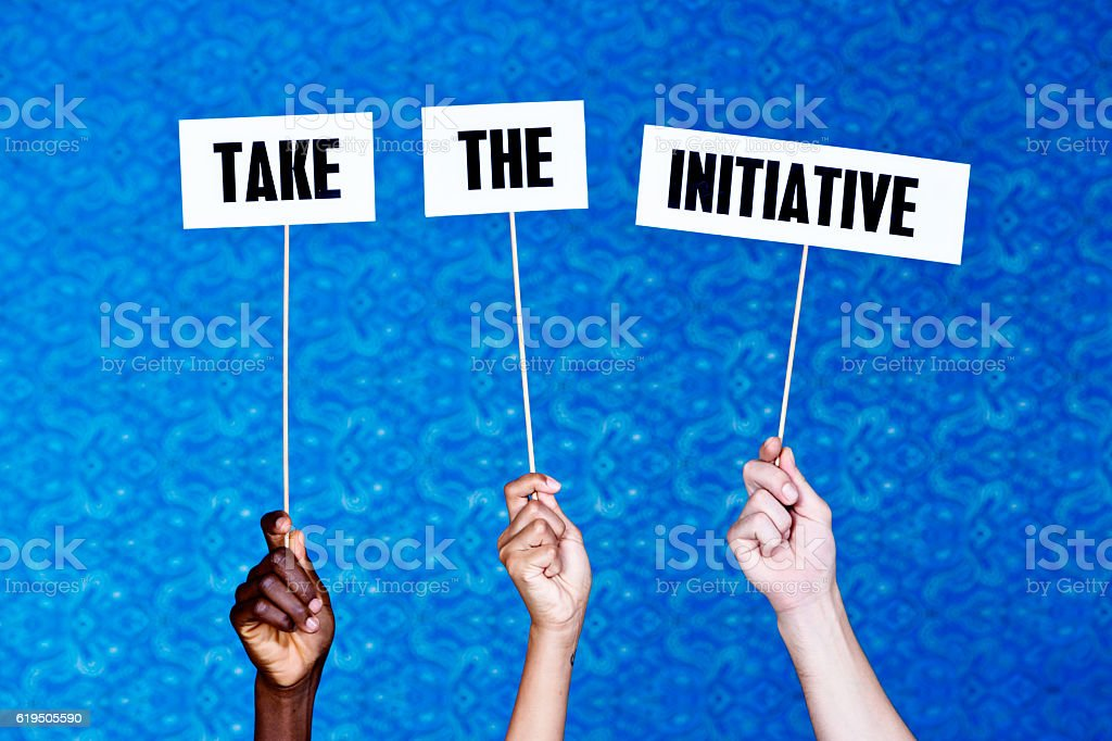 'Take the initiative' say hand-held signs stock photo