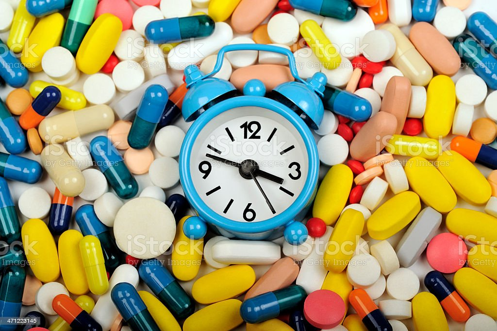 Take your pill on time. stock photo