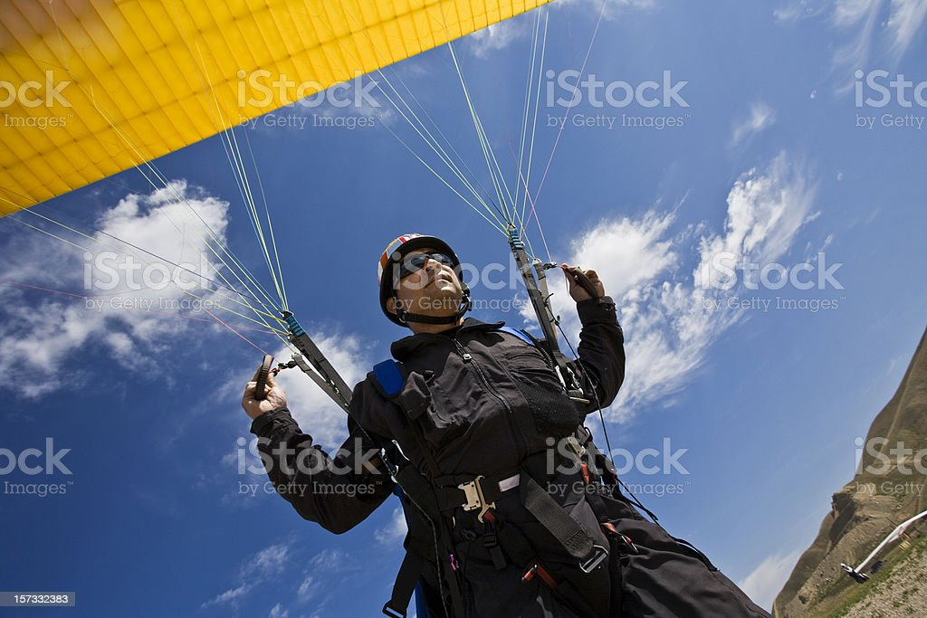 Take-off of a Paraglider stock photo