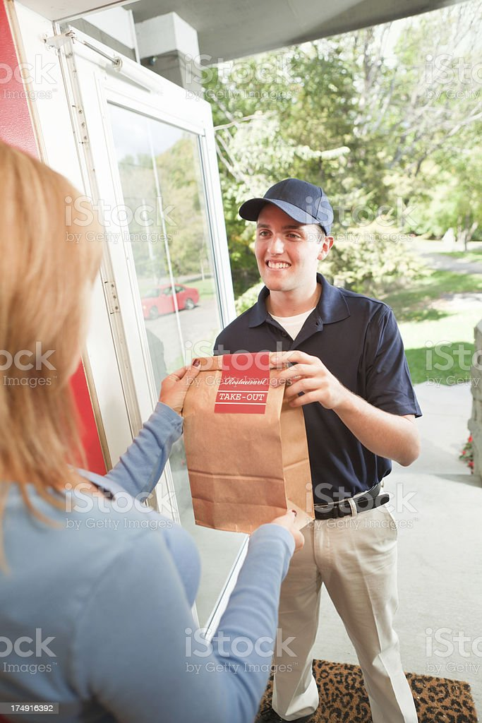 Take-out Food Delivery Man Arriving at Customer's Home Vt royalty-free stock photo