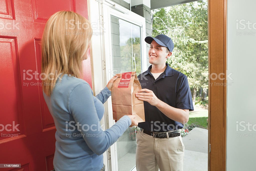 Take-out Food Delivery Service Arriving at Customer's Home Hz stock photo